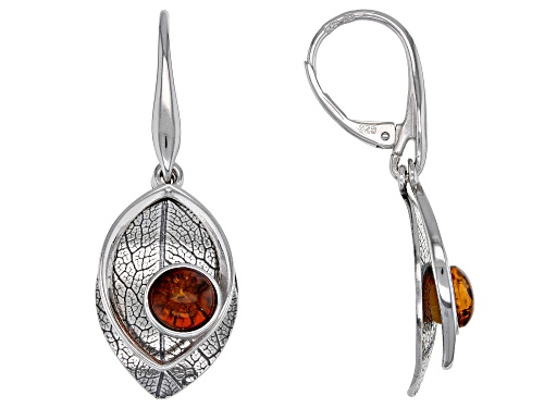Photo of 6mm round orange amber cabochon solitaire, rhodium over sterling silver dangle leaf earrings