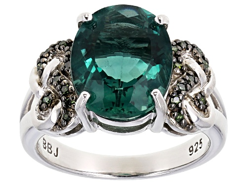 Photo of 4.42CT OVAL TEAL FLUORITE WITH .09CTW GREEN DIAMOND ACCENT RHODIUM OVER SILVER RING - Size 7