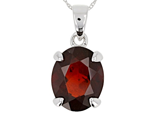 Photo of 3.65ct oval red hessonite garnet 10k white gold solitaire pendant with chain.