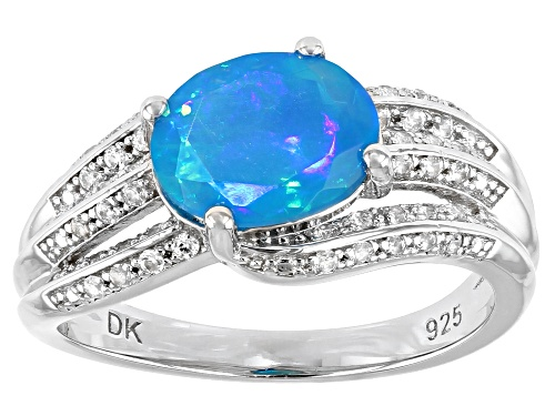 Photo of .77ct Oval Blue Opal and .20ctw Round White Zircon Rhodium Over Sterling Silver Ring - Size 8