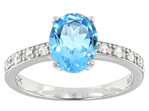Photo of 1.96ct Oval Swiss Blue Topaz and .20ctw Round White Zircon Rhodium Over Sterling Silver Ring - Size 8