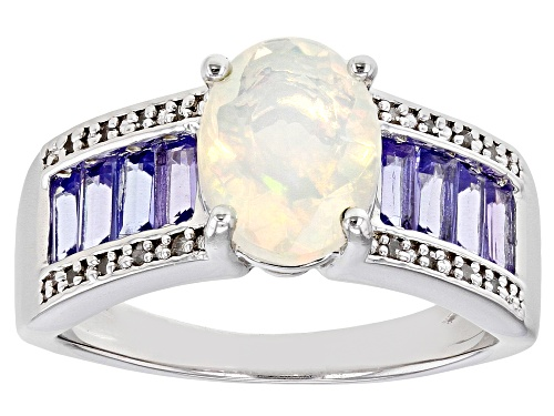 Photo of 1.10ct Oval Ethiopian Opal With .83ctw Tanzanite And Diamond Accent Rhodium Over Silver Ring - Size 8