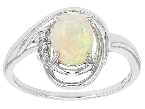 Photo of .55ct Oval Ethiopian Opal With .03ctw Round White Three Diamond Accents Sterling Silver Ring - Size 11