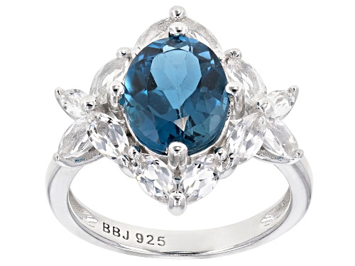 Photo of 3.40CT OVAL LONDON BLUE TOPAZ & 1.37CTW MARQUISE WHITE TOPAZ RHODIUM OVER SILVER RING - Size 8