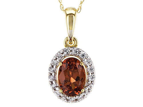 Photo of .88ct Oval Malaya Garnet And .13ctw Round White Zircon 14k Yellow Gold Pendant With Chain