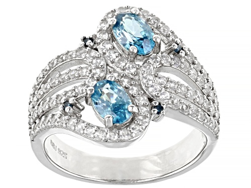 Photo of 1.31ctw Oval Blue Zircon, 1.05ctw White Zircon & Four Diamond Accent Rhodium Over Silver Ring - Size 10