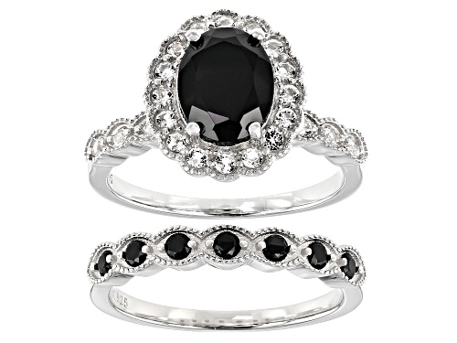 Photo of 1.70ct Oval and 0.24ctw Round Black Spinel With 0.51ctw Zircon Rhodium Over Silver Ring and Band Set - Size 8