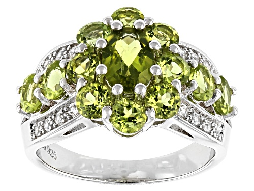 Photo of 2.68ctw Oval and Round Manchurian Peridot™ & .16ctw Zircon Rhodium Over Sterling Silver Ring - Size 7