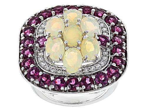 Photo of 4.61ctw Oval Ethiopian Opal, Round Rhodolite Garnet, And Round White Zircon Sterling Silver Ring - Size 7