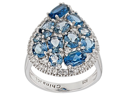 Photo of 3.87ctw Oval And Round London Blue Topaz With .55ctw White Zircon Rhodium Over Silver Ring - Size 7