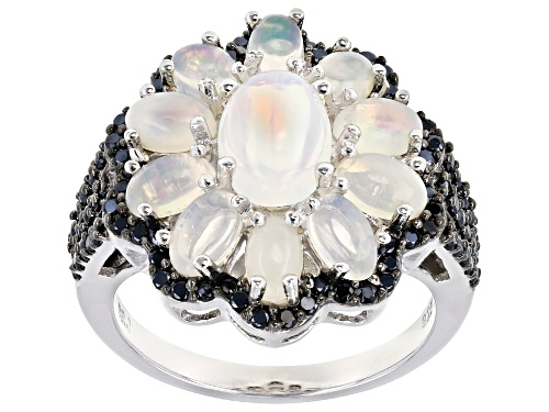 Photo of Oval Ethiopian Opal With .86ctw Round Black Spinel Rhodium Over Sterling Silver Ring - Size 8
