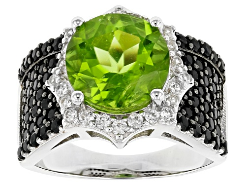 Photo of 4.05ct Round Peridot With 0.95ctw Black Spinel, And 0.55ctw White Zircon Rhodium Over Silver Ring - Size 7