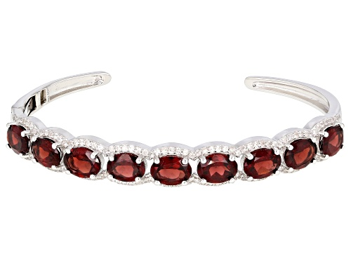 Photo of 9.90ctw Oval Garnet With 1.50ctw Round White Zircon Rhodium Over Sterling Silver Bracelet - Size 7