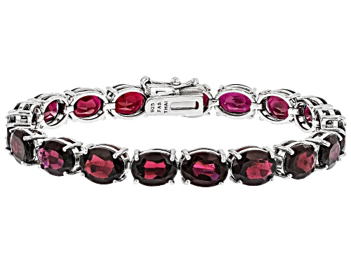Photo of 38.00ctw Oval Red Garnet Rhodium Over Sterling Silver Line Bracelet - Size 7.25