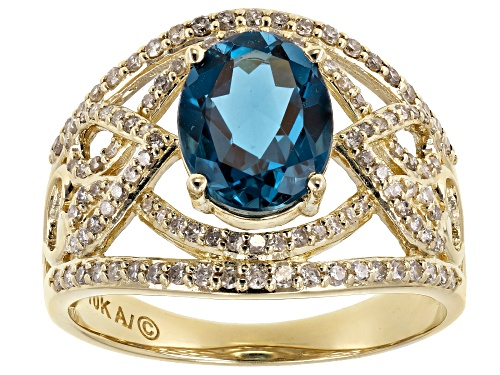 Photo of 2.00CT OVAL LONDON BLUE TOPAZ WITH .43CTW ROUND WHITE DIAMOND 10K YELLOW GOLD RING - Size 6