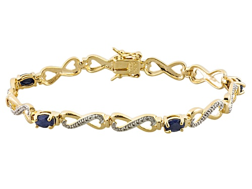 Photo of 2.32ctw Oval Blue Sapphire And .01ctw Single White Diamond Accent 14k Gold Over Silver Bracelet - Size 7