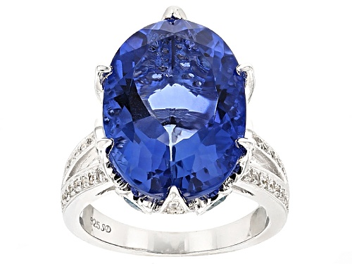 Photo of 14.33ct Color Change Blue Fluorite With .52ctw Swiss Blue Topaz And 1.00ctw White Zircon Silver Ring - Size 12