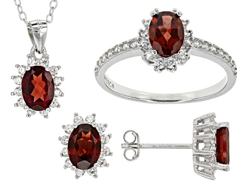 Photo of 4.00ctw Oval Red Garnet And1.41ctw Round White Zircon Silver Ring, Earrings And Pendant W/Chain Set