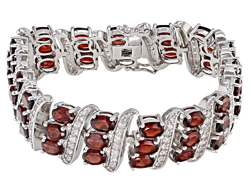 Photo of 28.50ctw Oval Red Garnet With 4.00ctw Round White Zircon Rhodium Over Sterling Silver Bracelet - Size 7