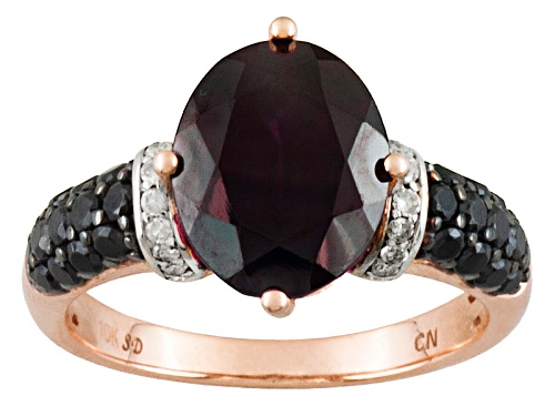 Photo of 5.00ct Oval Red Zircon With .35ctw Black Spinel And .08ctw White Diamond Accents 10k Rose Gold Ring - Size 12