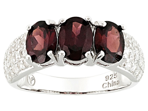 Photo of 3.00ct Oval Red Zircon And .93ctw Round White Zircon Sterling Silver 3-Stone Ring - Size 12