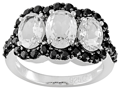 Photo of 2.75ctw Oval Goshenite And 0.50ctw Round Black Spinel Sterling Silver 3-Stone Ring - Size 11