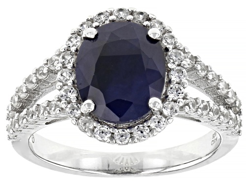 Photo of 2.00ctw Oval Sapphire With 1.00ctw Round White Zircon Rhodium Over Sterling Silver Ring - Size 7