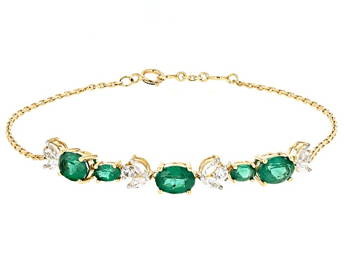 Photo of 2.75ctw Oval Emerald Color Apatite And .96ctw White Zircon 10k Yellow Gold Bracelet - Size 7.5