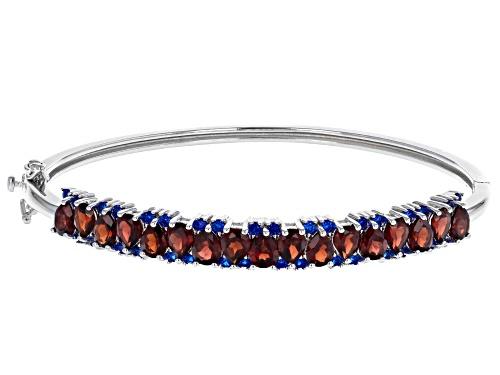 Photo of 6.05ctw Pear Shape Vermelho Garnet(TM), .84ctw Lab Blue Spinel Rhodium Over Silver Bangle Bracelet - Size 8