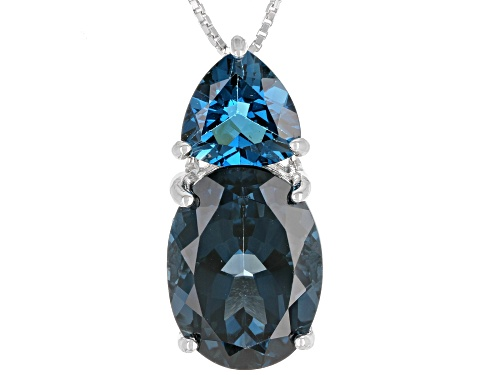 Photo of 10.20CT OVAL AND 2.76CT TRILLION LONDON BLUE TOPAZ RHODIUM OVER STERLING SILVER PENDANT WITH CHAIN