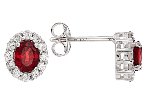 Photo of .83ctw Oval Red Sapphire And .42ctw Round White Zircon Sterling Silver Stud Earrings