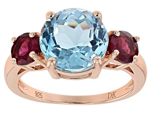 Photo of 3.75ct Round Glacier Topaz(TM), 1.10ctw Raspberry Color Rhodolite 18k Gold Over Silver 3-Stone Ring - Size 9
