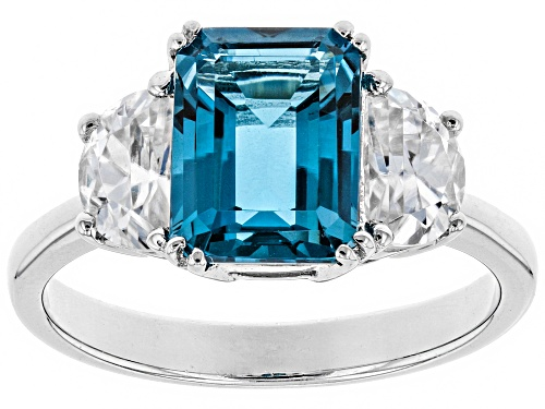 Photo of 2.55CT EMERALD CUT LONDON BLUE TOPAZ WITH 1.19CTW CRESCENT WHITE ZIRCON RHODIUM OVER SILVER RING - Size 7
