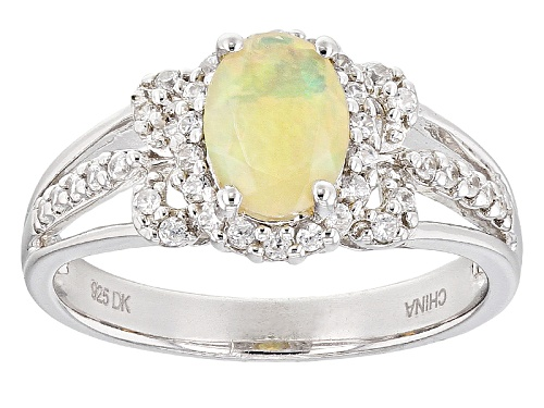 Photo of .55ctw Oval Ethiopian Opal With .40ctw Round White Zircon Sterling Silver Ring - Size 7