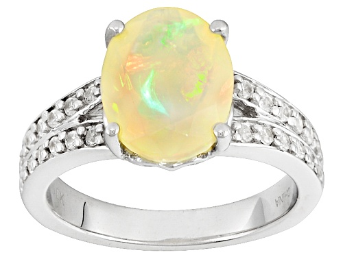 Photo of 1.25ct Oval Ethiopian Opal With .21ctw Round White Zircon Sterling Silver Ring - Size 10