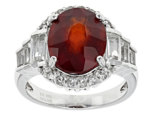 Photo of 3.78ct Oval Hessonite Garnet And 1.08ctw Round And Baguette White Topaz Sterling Silver Ring - Size 8