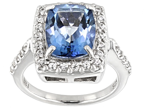 Photo of 4.83ct cushion Blue Turquoise™ color topaz & .65ctw round white zircon rhodium over silver ring - Size 7