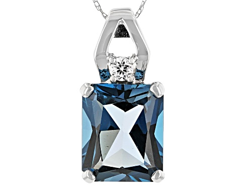 Photo of 6.38ct London Blue Topaz With 0.13ctw White Zircon Rhodium Over 10k White Gold Pendant With Chain