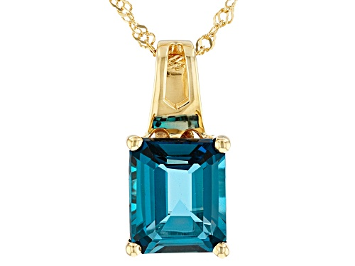 Photo of 6.37ct emerald cut London blue topaz 18k yellow gold over sterling silver pendant with chain