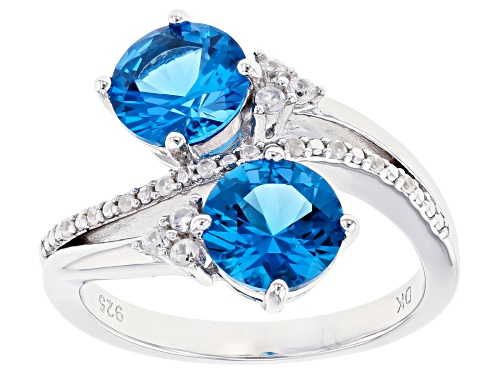 Photo of 2.52ctw Round Lab Created Blue Spinel With .23ctw Zircon Rhodium Over Silver Bypass Ring - Size 10