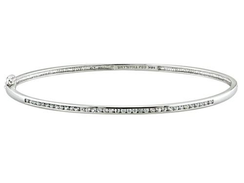 Photo of .61ctw Round White Zircon 10k White Gold Hinged Bangle Bracelet - Size 7.25