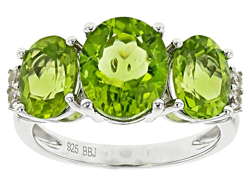 Photo of 4.60ctw Oval Manchurian Peridot™ With .11ctw Round White Zircon Sterling Silver 3-Stone Ring - Size 5