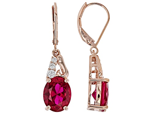 Photo of 5.78ctw Oval Lab Created Ruby & .26ctw Zircon 18k Rose Gold Over Silver Earrings