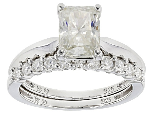 Photo of Moissanite Fire® 2.13ctw Dew Radiant Cut And Round Platineve™ Ring With Band - Size 11