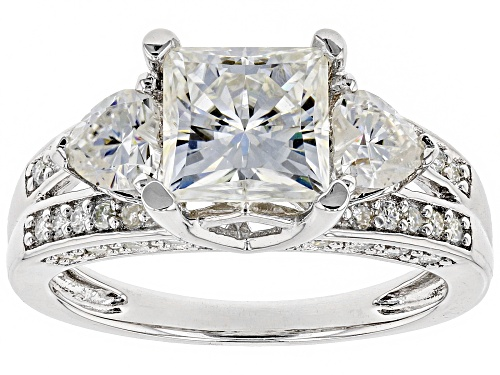 Photo of MOISSANITE FIRE® 3.14CTW DEW SQUARE BRILLIANT AND HEART SHAPE WITH ROUND PLATINEVE™ RING - Size 8