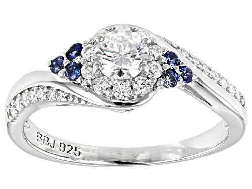 Photo of MOISSANITE FIRE(R) .67CTW DEW ROUND  AND .13CTW ROUND BLUE SAPPHIRE PLATINEVE(R) RING - Size 11