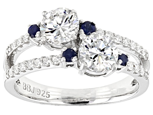 Photo of MOISSANITE FIRE(R) 1.40CTW DEW ROUND .15CTW ROUND BLUE SAPPHIRE PLATINEVE(R) RING - Size 10