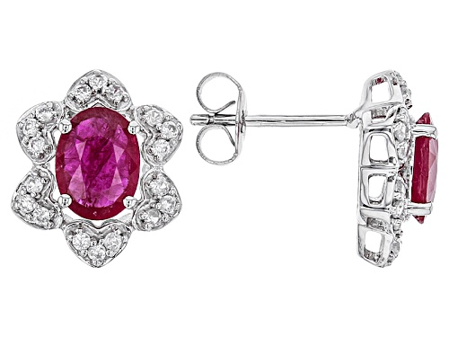 2.70ct Oval Ruby With .58ctw Round White Zircon 10k White Gold Earrings