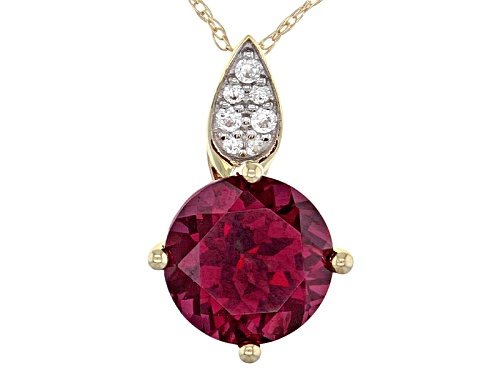 Photo of 1.80ct Round Grape Color Garnet With .06ctw Round White Zircon 10k Yellow Gold Pendant With Chain.