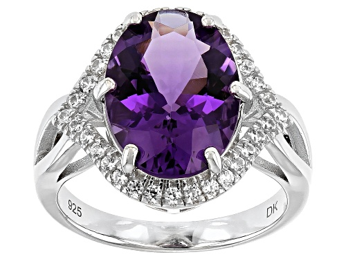 Photo of 5.02ct Oval Brazilian Amethyst and 0.72ctw Zircon Rhodium Over Silver Ring - Size 8